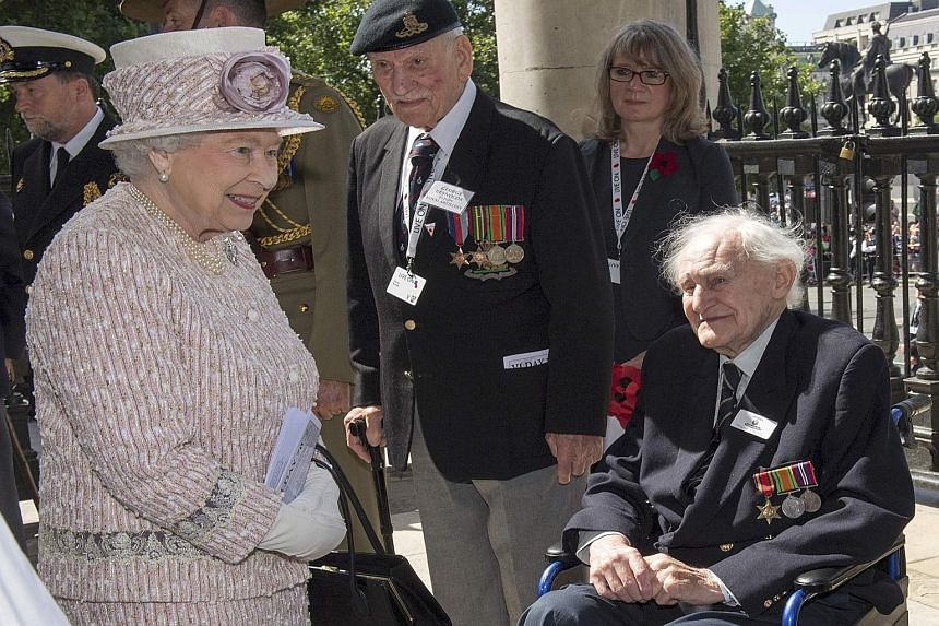 Queen Elizabeth greets veterans as she leaves St Martin's-in- the-Fields church. She was there to attend a service commemorating the 70th anniversary of VJ Day in London on Saturday.