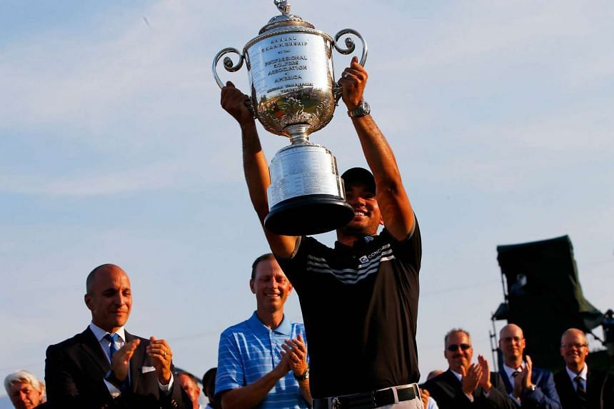 Jason Day holding aloft the Wanamaker trophy after his record 20-under par victory at the PGA Championship.