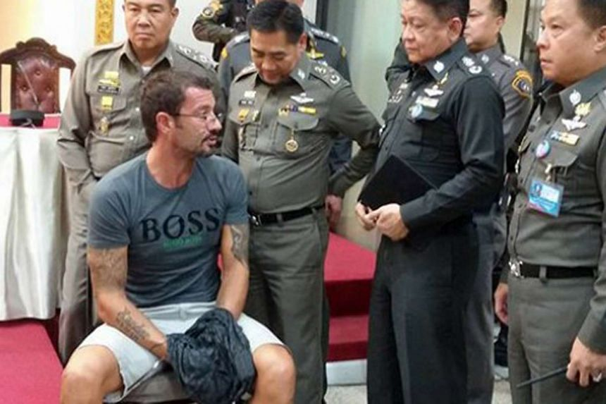 Swiss national Xavier Andre Justo (seated) was sentenced to three years' jail, after he was arrested for allegedly blackmailing his former employer PetroSaudi International over the 1MDB case.