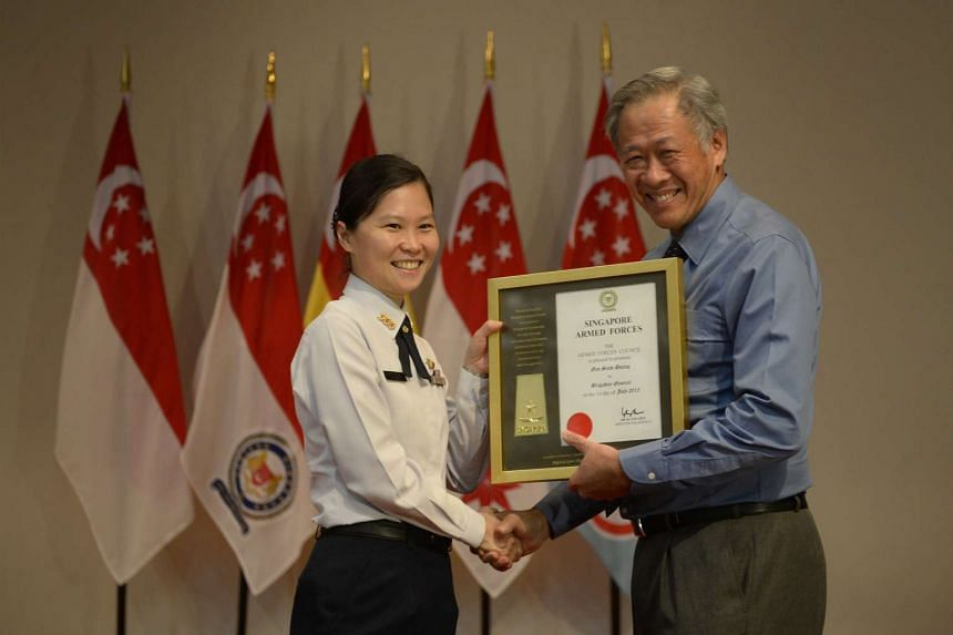 Then Colonel Gan Siow Huang receiving her certificate of promotion from Defence Minister Ng Eng Hen, making her the first woman general in Singapore, at Mindef on June 26, 2015.