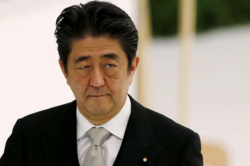 Japan's Prime Minister Shinzo Abe attends a memorial service ceremony marking the 70th anniversary of Japan's surrender in World War II at Budokan Hall in Tokyo on Aug 15, 2015.