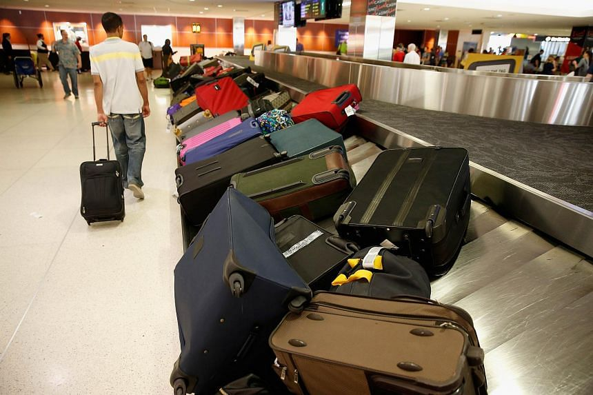 Bags sit on a carsoul in the Southwest baggage claim area at Baltimore/Washington International Thurgood Marshall Airport as flights are delayed due to technical issues at a Federal Aviation Administration center on Aug 15, 2015 in Linthicum, Marylan