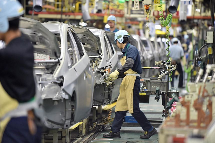 This file picture taken on Dec 4, 2014 shows an assembly line for Japanese auto giant Toyota Motor's hybrid vehicle Prius at the company's plant in Toyota in Aichi prefecture, central Japan.