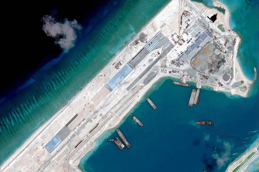 This file handout photo taken on April 2, 2015 by satellite imagery provider DigitalGlobe, Asia Maritime Transparency Initiative department at the Center for Strategic and International Studies think tank shows a satellite image of what is claimed to