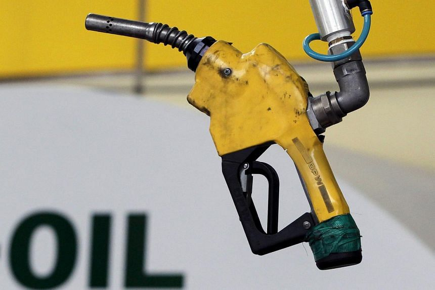 Oil prices fell in early Asian trading on Monday as Japan's economy contracted on the back of falling exports and consumer spending.