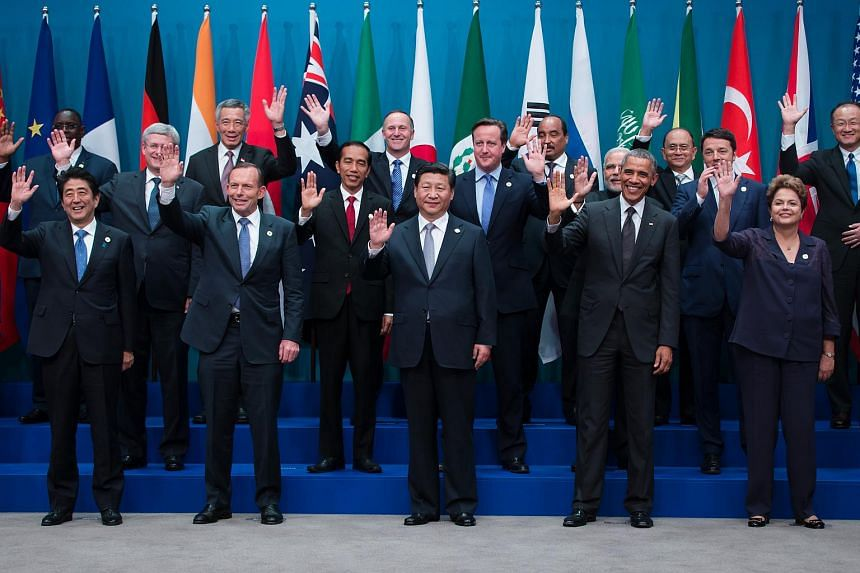 World leaders and delegates, including US President Barack Obama and Chinese President Xi Jinping at the Group of 20 (G-20) summit in Brisbane on Nov 15, 2014.