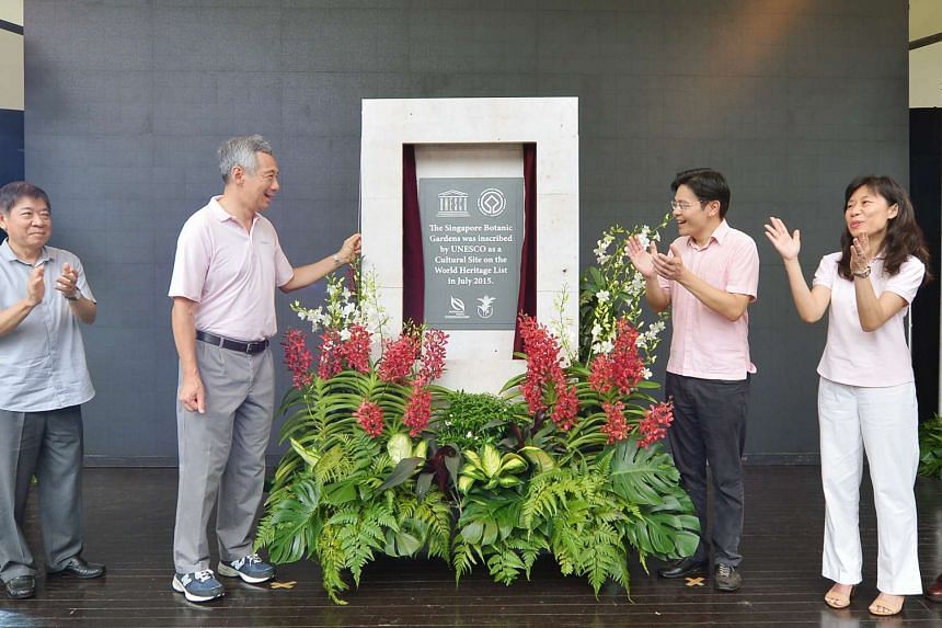 PM Lee Hsien Loong (left) and Minister for Culture, Community and Youth Lawrence Wong unveiling the Singapore Botanic Gardens' Unesco World Heritage Site plaque