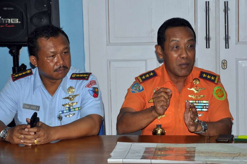 Chief of the Indonesian National Search and Rescue Agency (BASARNAS) Bambang Soelistyo (right), accompanied by Jayapura military air base commander Colonel I Made Susila Adyana, speaks during a press conference at Sentani airport near Jayapura, Indon