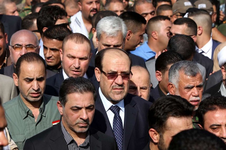 Iraq's Vice President Nuri al-Maliki (centre) taking part in a funeral on July 14 in the capital Baghdad. The ex-PM is accused of being connected with the fall of Mosul to the Islamic State in Iraq and Syria (ISIS).