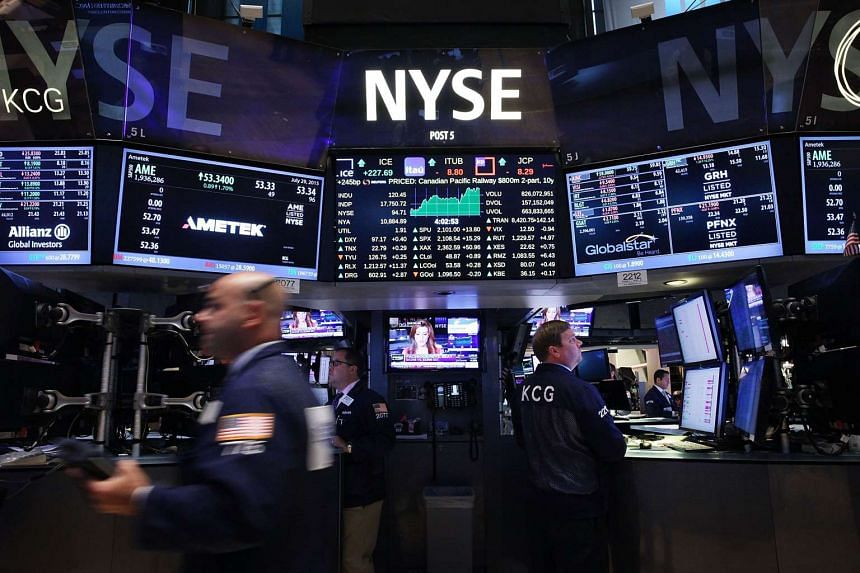 Traders work on the floor of the New York Stock Exchange (NYSE) on July 29.