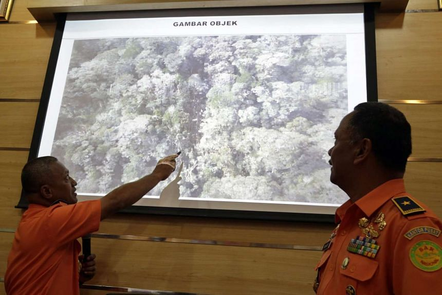 Representatives from the Indonesian National Search and Rescue Agency show a picture of the suspected crash site of a Trigana Air ATR 42 plane shortly after a press conference in Jakarta, Indonesia on Aug 17.