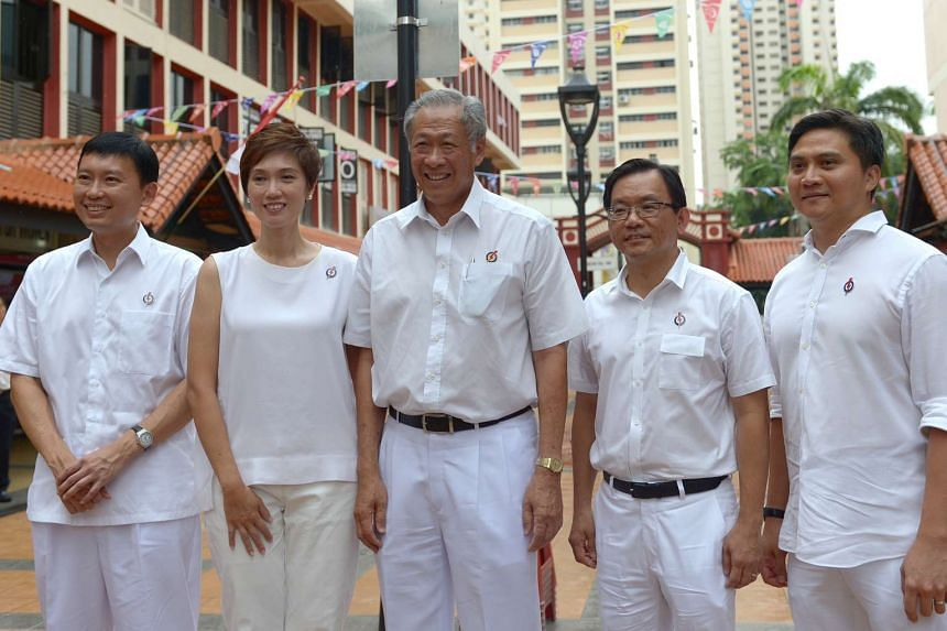 Dr Ng Eng Hen (centre) with the other four members of his Bishan-Toa Payoh GRC team (from left) Chee Hong Tat, Josephine Teo, Chong Kee Hiong and Saktiandi Supaat.