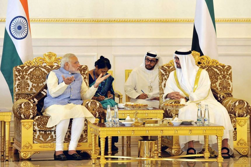 India's Prime Minister Narendra Modi (left) gestures as he speaks with The Crown Prince of Abu Dhabi, His Highness Sheikh Mohammed bin Zayed Al Nahyan during a meeting in Abu Dhabi.