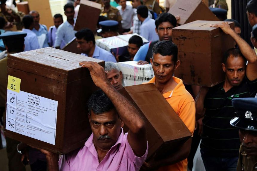 Election officials carry ballot boxes to polling centers one day ahead of the general elections in Colombo, Sri Lanka on Aug 16, 2015.
