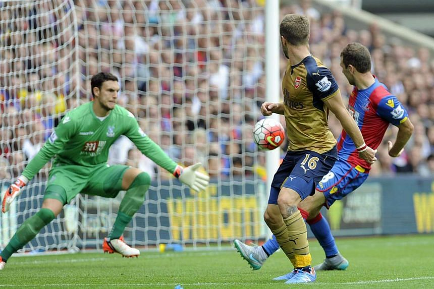 Arsenal's Aaron Ramsey (centre) goes close with a backflick attempt on goal against Crystal Palace during the English Premier League soccer match between Crystal Palace and Arsenal at Selhurst Park in London on Sunday. Arsenal won 2-1.