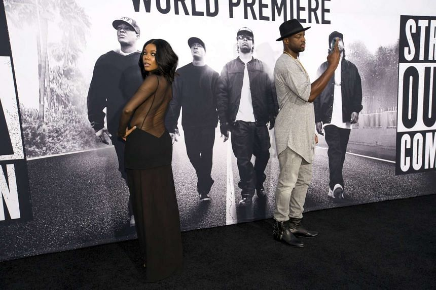 NBA player Dwyane Wade takes a photo of his wife actress Gabrielle Union at the premiere of Straight Outta Compton in Los Angeles, California last week.