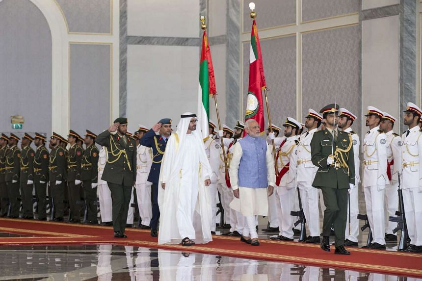 A picture made available by the United Arab Emirates' official news agency WAM on Sunday shows Sheikh Mohamed bin Zayed Al Nahyan Crown Prince of Abu Dhabi (left) and Indian Prime Minister Narendra Modi inspecting the honour guard during a reception