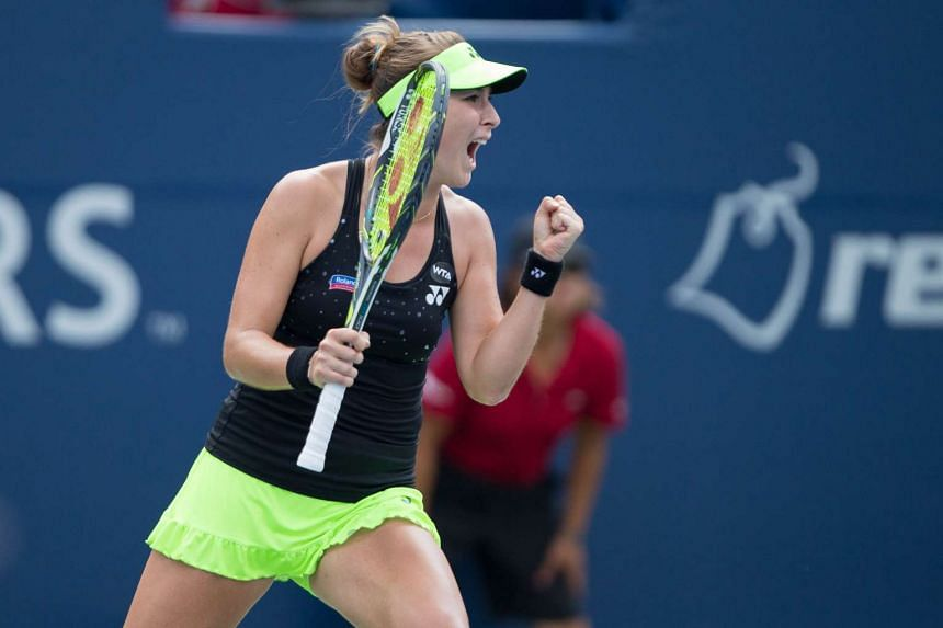 Belinda Bencic of Switzerland celebrates her win in the first set tie breaker against Simona Halep of Romania during their Rogers Cup tennis final at the Aviva Centre at York University in Toronto, Canada on Sunday.