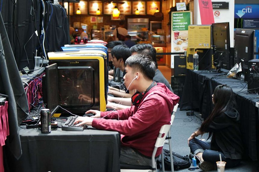 """Joel """"Chibix"""" Chan, 21, from team First Departure during the Dota 2 finals of the Armaggeddon Gaming Festival. First Departure won the finals 2-0."""