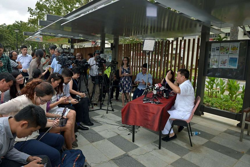 Mr Sitoh greeting reporters at the start of his press conference at the Kallang River ABC Park.