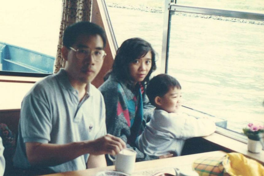 Dr Tang with jazz maestro Jeremy Monteiro in 1981 during a SAF Music and Drama Company tour in the Philippines and with his wife, Ms Tan Mui Tin, and their first-born son, Brendan, then aged two, on a trip to Germany in 1996 (above).