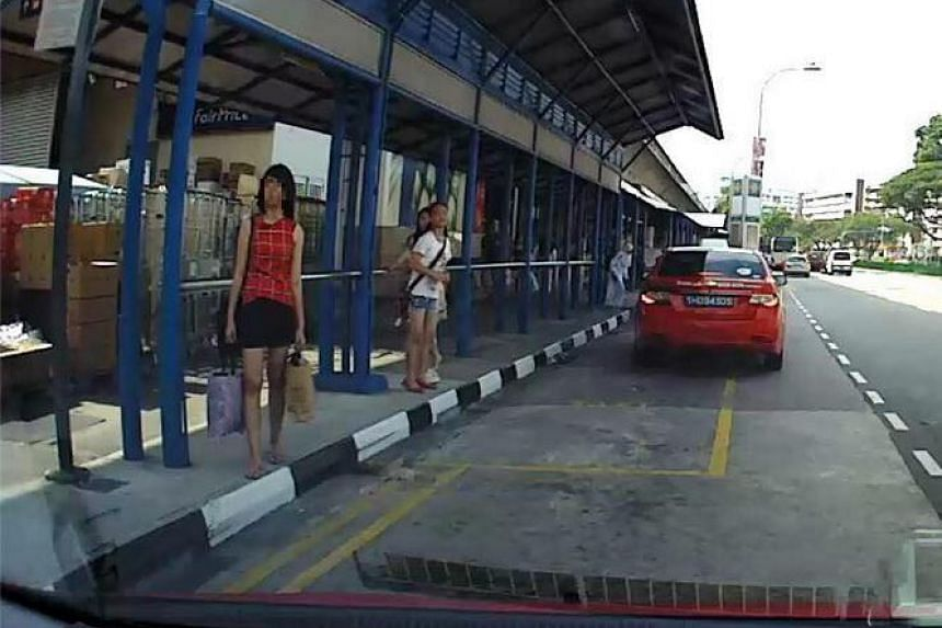 The women, dressed in a red top and black shorts, allegedly cheated a taxi driver of his cab fare.