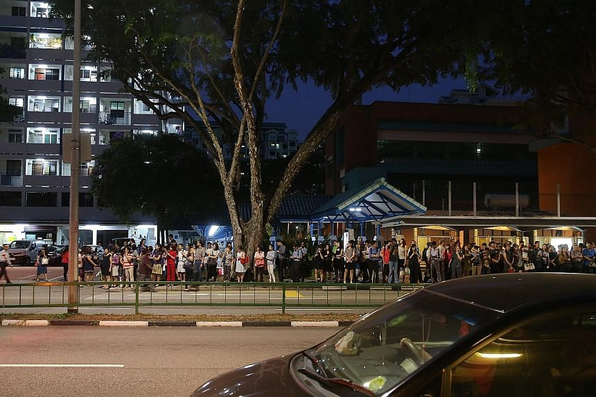 The crowd at a bus stop outside Braddell MRT station on July 7, after a massive breakdown on the North-South and East-West lines.