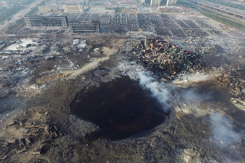 GROUND ZERO: The destruction spanned an area 3km in radius, leaving a large hole in the ground where the explosions took place (above) .
