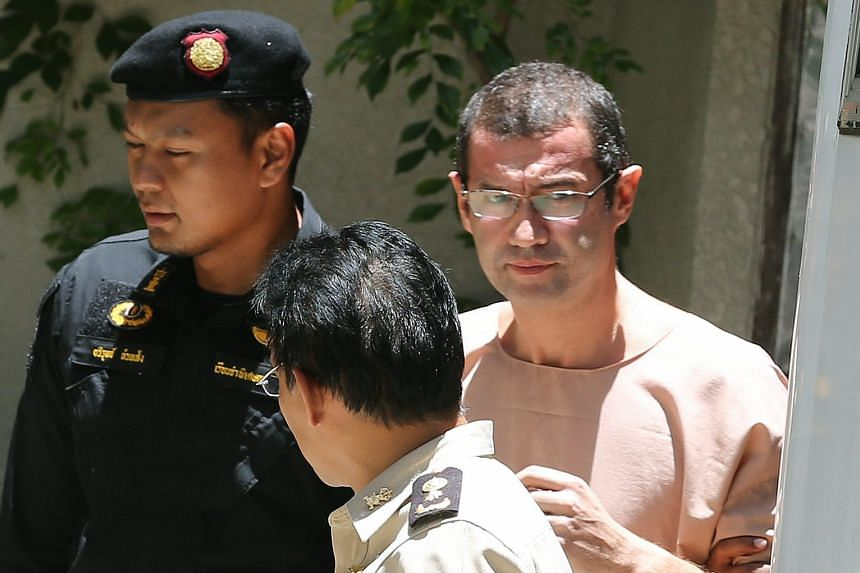 Swiss national Xavier Justo (right) being escorted from a Bangkok court yesterday. Documents, purportedly from him, showing financial mismanagement at 1MDB were published online in May.