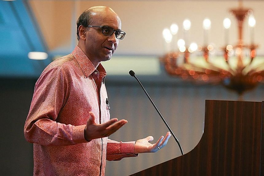 """Mr Tharman Shanmugaratnam (far left) said in Parliament that the """"whole house of AHPETC's finances is unsafe"""". Ms Sylvia Lim (left) rose twice to clarify that its auditors said AHPETC's latest set of accounts, except for certain specific issues, had"""