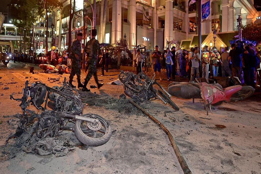 Thai soldiers patrolling the scene of the bomb blast in central Bangkok. The blast came from a planted blomb which went off just metres from the popular Erawan Shrine at about 7pm yesterday, killing at least 16 people and injuring some 80. Body parts
