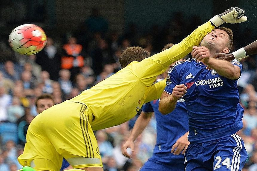 Chelsea defender Gary Cahill ends up with a bloody nose after goalkeeper Asmir Begovic tries to punch the ball clear during the match with Manchester City.