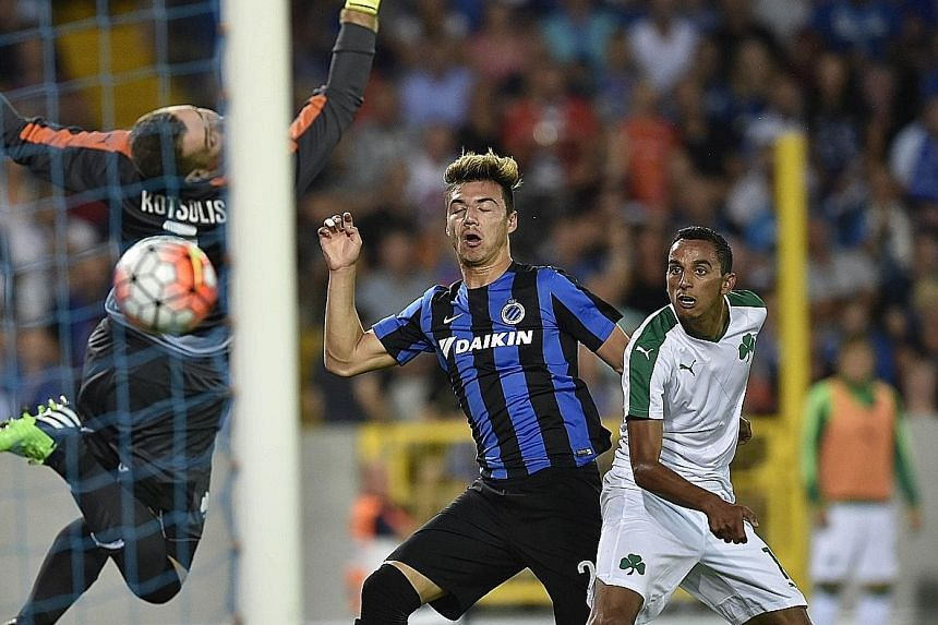 Club Brugge's right-back Dion Cools (centre) scoring against Panathinaikos to help his team book a place in the Champions League play-offs, with English giants Manchester United lying in wait tonight. The Malaysia-born teenager is a regular with the