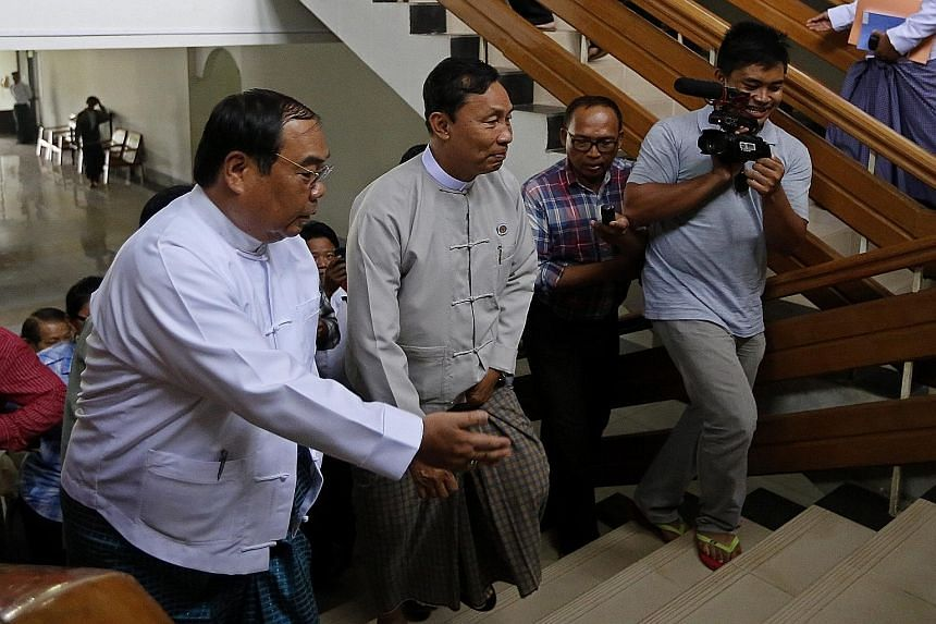 """Speaker of Parliament Shwe Mann (centre) arriving at an event in Naypyitaw yesterday. The former top general could be impeached based on a petition signed by over 1,700 members of his own constituency, for his """"disrespect"""" towards the military's role"""