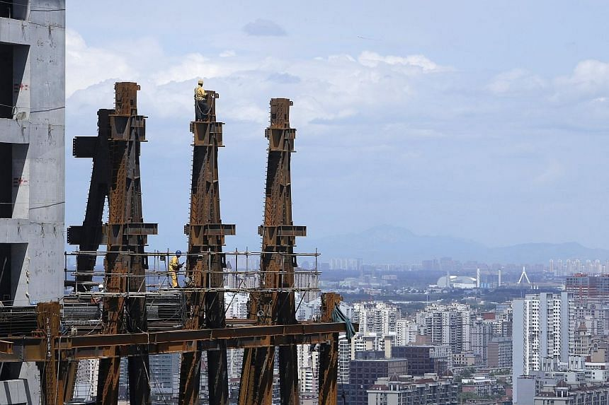 A high-rise in Beijing under construction. Amid a year-long slump in China's housing market, there are fears that bubbles are forming in some big cities, even as prices in smaller cities languish.