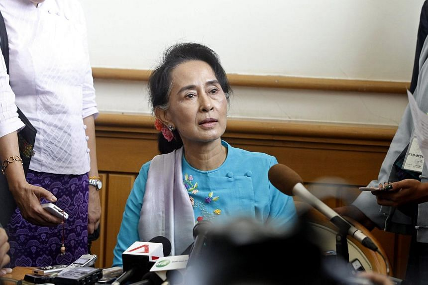 Myanmar opposition leader Aung San Suu Kyi (centre) during a press conference in Naypyitaw, Myanmar on Aug 18, 2015.