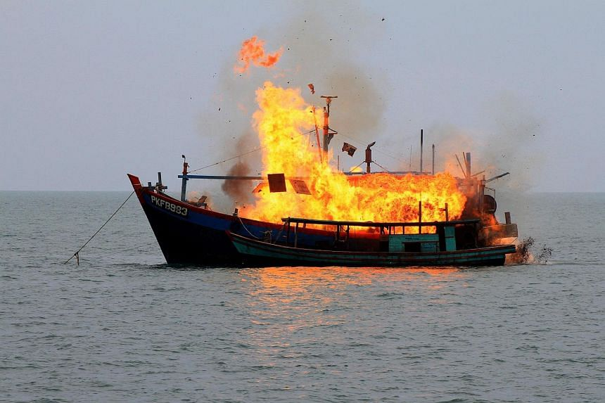 A Malaysian fishing boat seized by Indonesian authorities for illegal fishing is detonated and sunk by Indonesian Navy personnel on Aug 18, 2015.