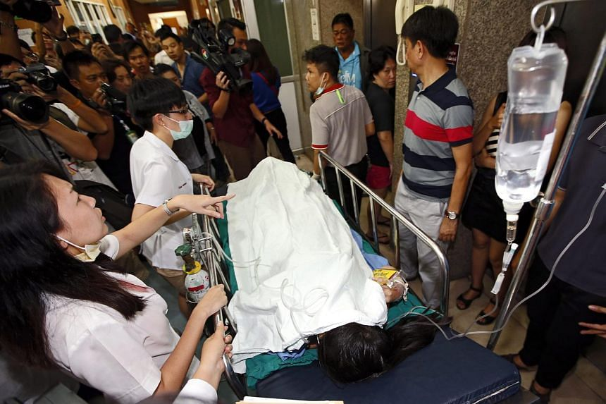 An injured person is rushed to Police Hospital after a bomb explosion near Erawan Shrine, central Bangkok, Thailand, Aug 17, 2015.