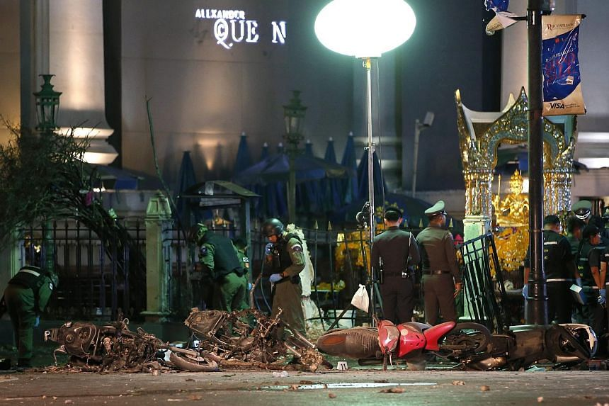 Members of Explosive Ordnance Disposal (EOD) and Thai forensic police officers inspect a blast site after an explosion outside Erawan Shrine in central of Bangkok, Thailand on Aug 17,  2015.