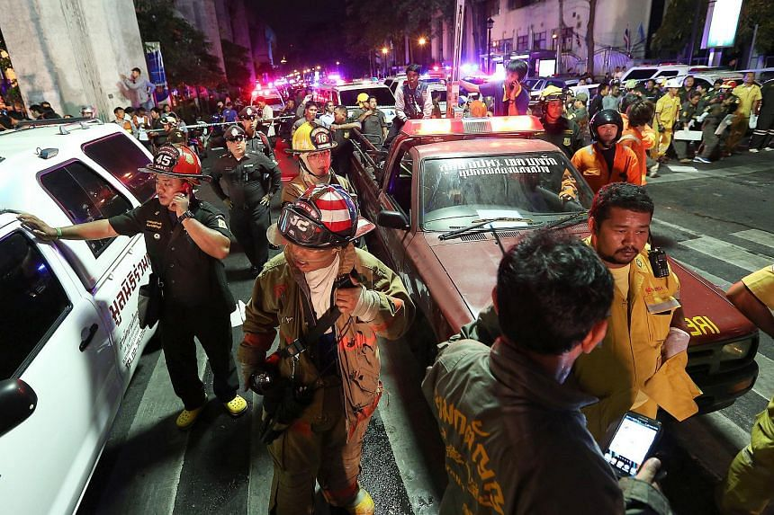 Emergency vehicles and members of the Fire Department arrive to assist following an explosion at the Ratchaprasong intersection in Bangkok, Thailand, on Aug 17, 2015.