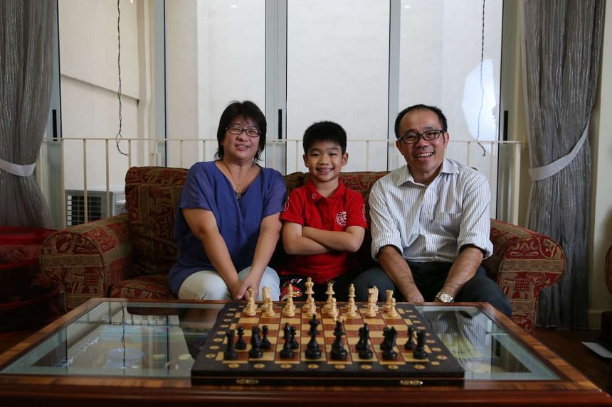 Mark with his father Harry Sim Lim Onn, 48, and mother Wun Ju Sing, 46 in their home.