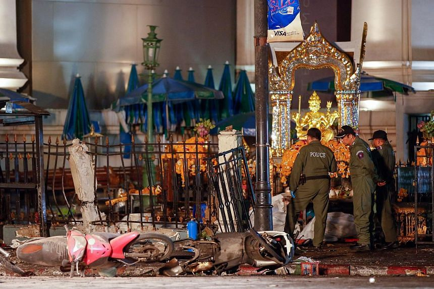 Police officers inspect the scene of an explosion near Erawan Shrine, central Bangkok, Thailand on Aug 17, 2015.