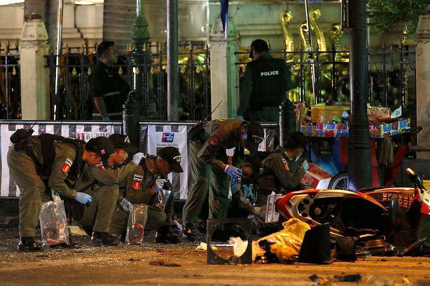 Members of Explosive Ordnance Disposal (EOD) and Thai forensic police officers inspect a blast site after an explosion outside Erawan Shrine in central of Bangkok, Thailand, on Aug 17, 2015.