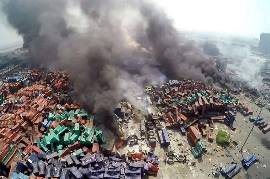 Smoke billowing from burning containers after an explosions at a seaport in Tianjin, China on Aug 13, 2015.