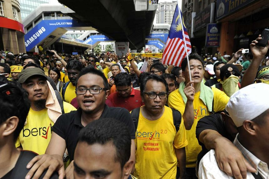 A huge crowd walking to the outskirts of Dataran Merdeka in Kuala Lumpur on April 28, 2012, for the Bersih 3.0 rally.