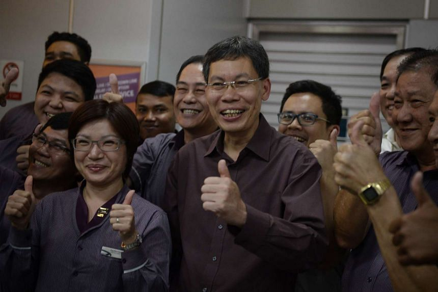 Mr Lui (centre) had said in a surprise announcement last week that he was leaving politics after what is only his second term as an MP.