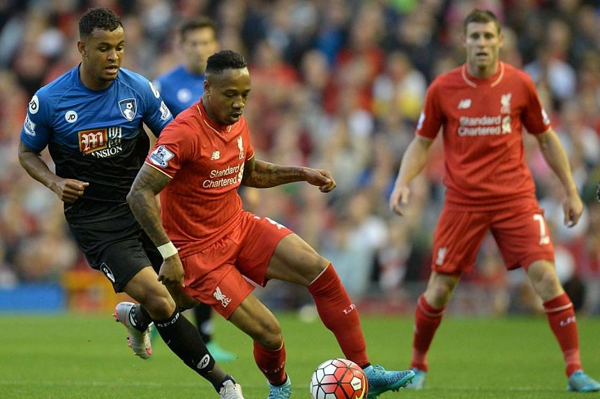 Liverpool Defender Nathaniel Clyne (centre) in action against Bournemouth striker Joshua King during the match between Liverpool and Bournemouth on Aug 17, 2015.