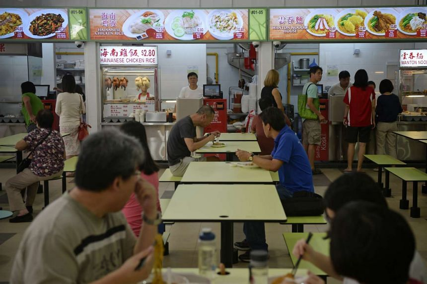 Customers and stalls at the Hougang hawker centre in Ci Yuan Community Club on Aug 14, 2015.
