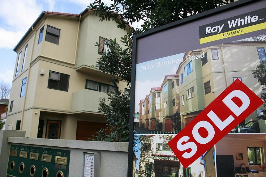 """A """"SOLD"""" sign is displayed in front of a property in Auckland, New Zealand."""
