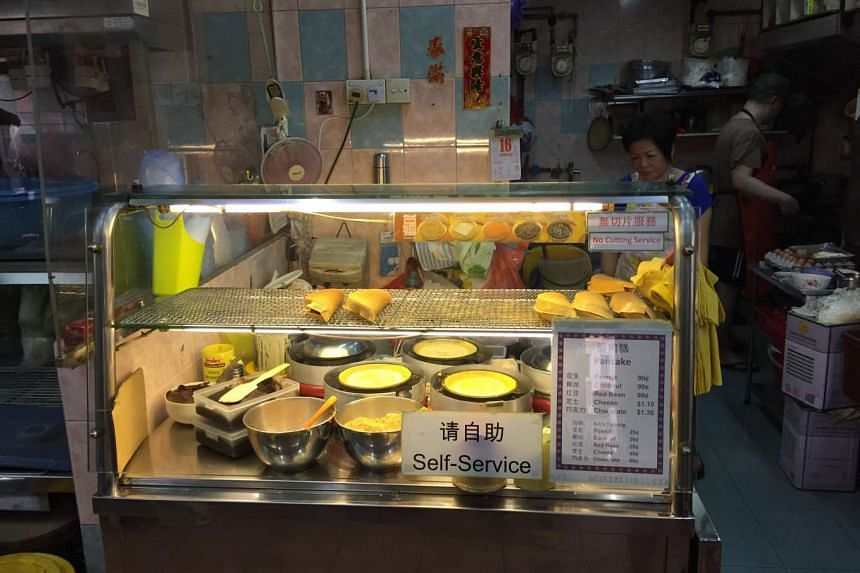 The peanut pancake stall located in a corner coffeeshop at Block 136, Potong Pasir Ave 3.